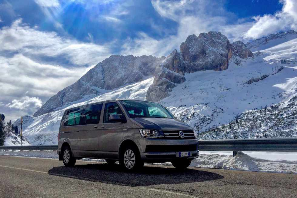 Van Volkswagen Caravelle at Passo Fedaia in Val di Fassa with the Marmolada on the background