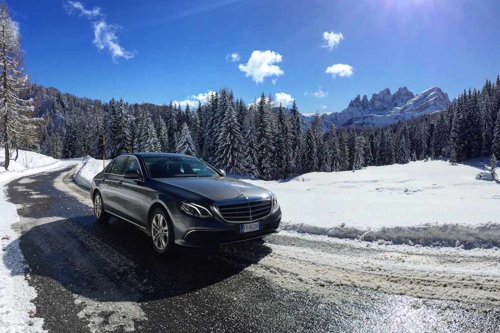 Vehicle Mercedes-Benz at the Passo San Pellergino in Val di Fassa during winter